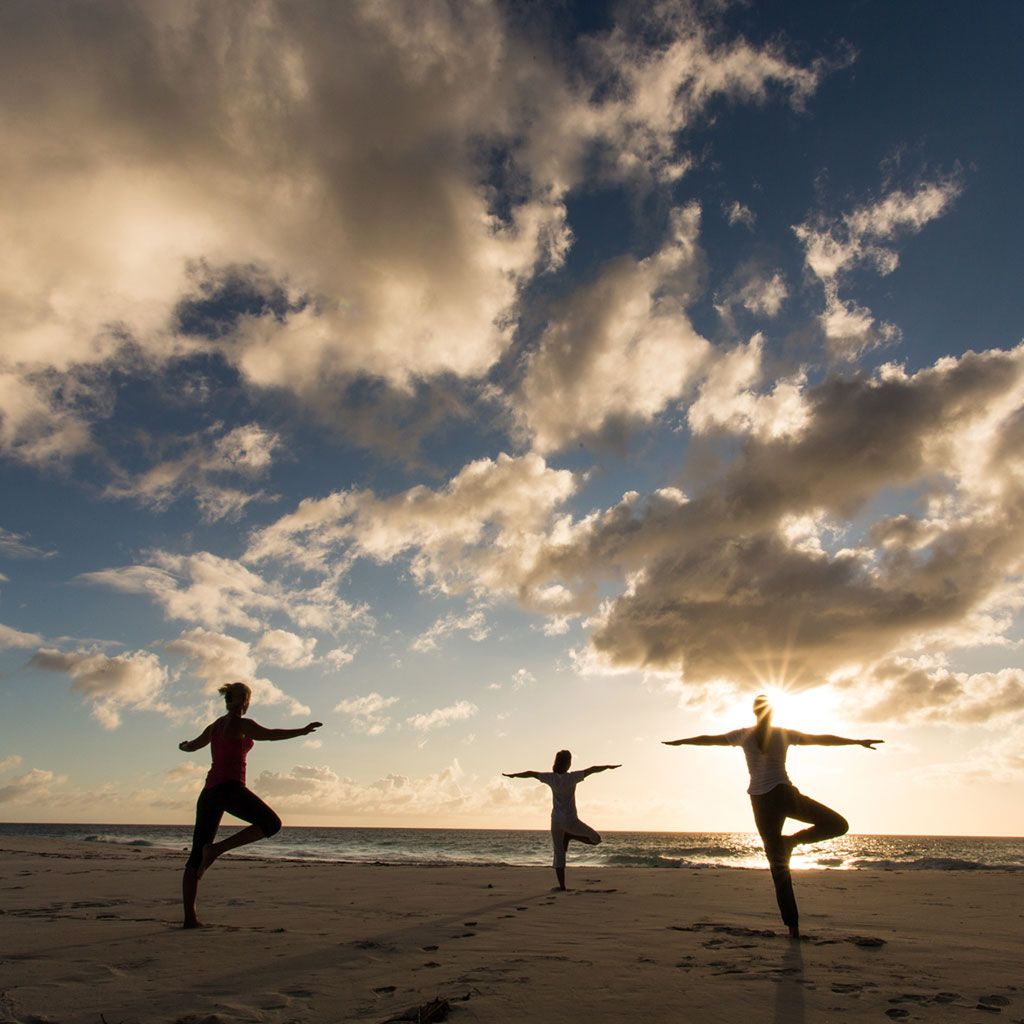 Northisland island wellness 5 north island seychelles yoga to greet the sun kristyandbryce Images