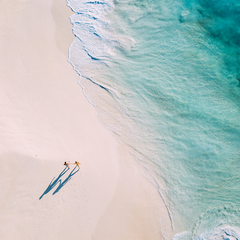 Couple walking on private beach